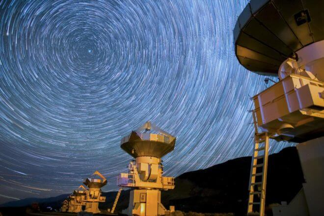 A screenshot from a time lapse video of radio telescopes by Harun Mehmedinovic and Gavin Heffernan of Sunchaser Pictures was shot at several different radio astronomy facilities—the Very Large Array (VLA) Observatory in New Mexico, Owens Valley Observatory in Owens Valley California, and Green Bank Observatory in West Virginia. All three of these facilities have been or are still being partly used by the SETI (Search for the Extraterrestrial Intelligence) program. You can watch the video at: https://www.youtube.com/watch?v=SrxpgUJoHRc