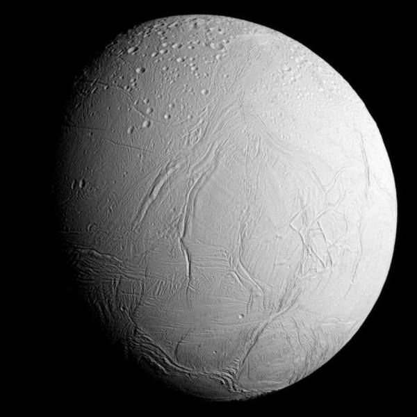 NASA's Cassini spacecraft captured this view as it neared icy Enceladus for its closest-ever dive past the moon's active south polar region. The view shows heavily cratered northern latitudes at top, transitioning to fractured, wrinkled terrain in the middle and southern latitudes. The wavy boundary of the moon's active south polar region -- Cassini's destination for this flyby -- is visible at bottom, where it disappears into wintry darkness. This view looks towards the Saturn-facing side of Enceladus. North on Enceladus is up and rotated 23 degrees to the right. The image was taken in visible light with the Cassini spacecraft narrow-angle camera on Oct. 28, 2015. The view was acquired at a distance of approximately 60,000 miles (96,000 kilometers) from Enceladus and at a Sun-Enceladus-spacecraft, or phase, angle of 45 degrees. Image scale is 1,896 feet (578 meters) per pixel.