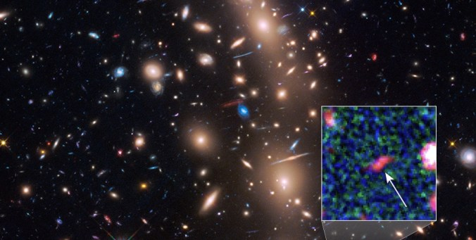 Faintest distant galaxy ever detected, formed only 400 million years after the Big Bang. NASA, ESA, and L. Infante (Pontificia Universidad Catolica de Chile)