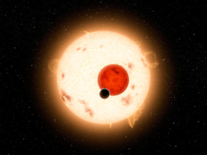 An artist's rendering of the Kepler-16 system, showing the binary star being orbited by Kepler-16b