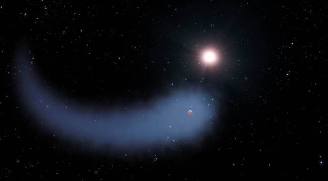 """In this artist's concept shows """"The Behemoth,"""" an enormous comet-like cloud of hydrogen bleeding off of a warm, Neptune-sized planet just 30 light-years from Earth. The hydrogen is evaporating from the planet due to extreme radiation from the star, but on many exoplanets it remains a thick covering. (NASA, ESA, and G. Bacon, STScI)"""