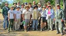 A group picture with the Memorial Day field crew at the Block 17 garden pond. Photo by Jeff Burton, courtesy of NPS.