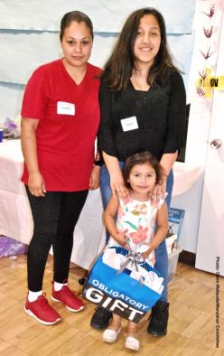 A very young raffle winner!—the Mejia Famiiy