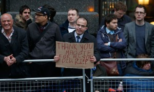 Funeral preparations: Spectators gather on the route near St Paul's Cathedral in London