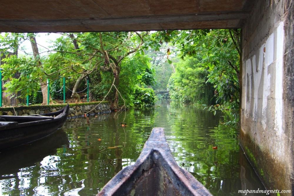 Kerala backwaters canoe under bridge