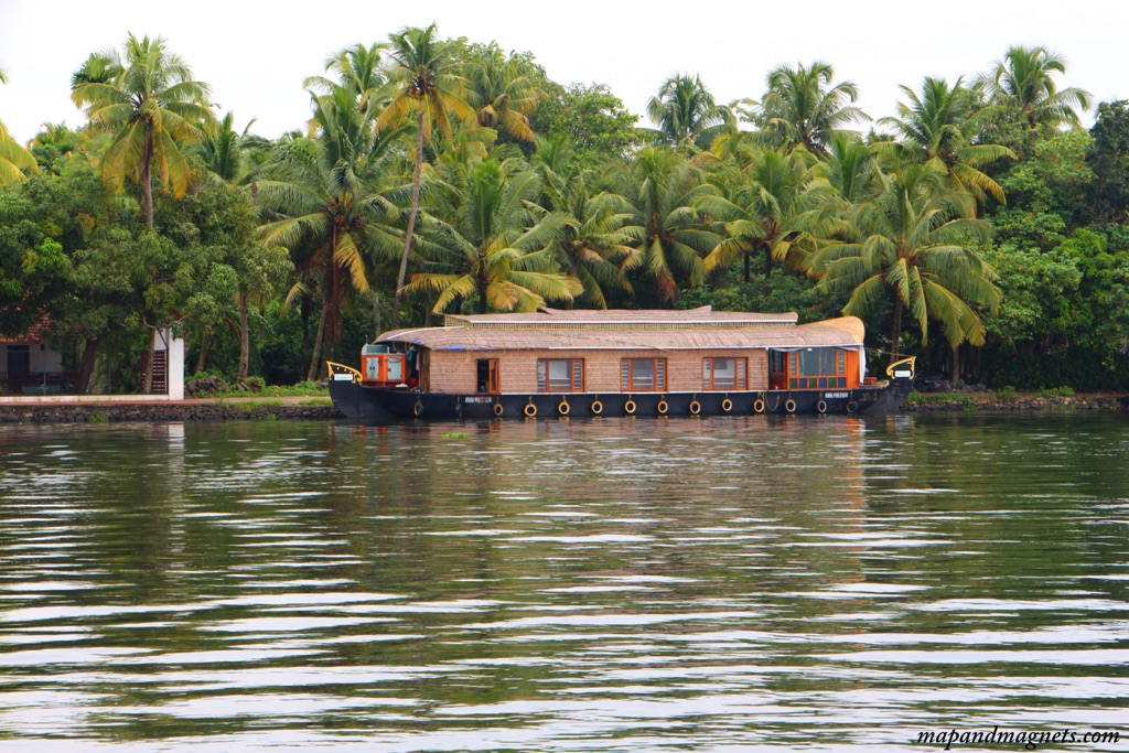 Kerala backwaters classic houseboat and palm trees