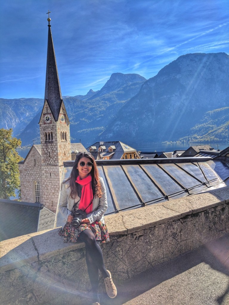 Sitting by the church in Hallstatt