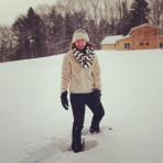 Meredith snowshoeing in front of the new barn