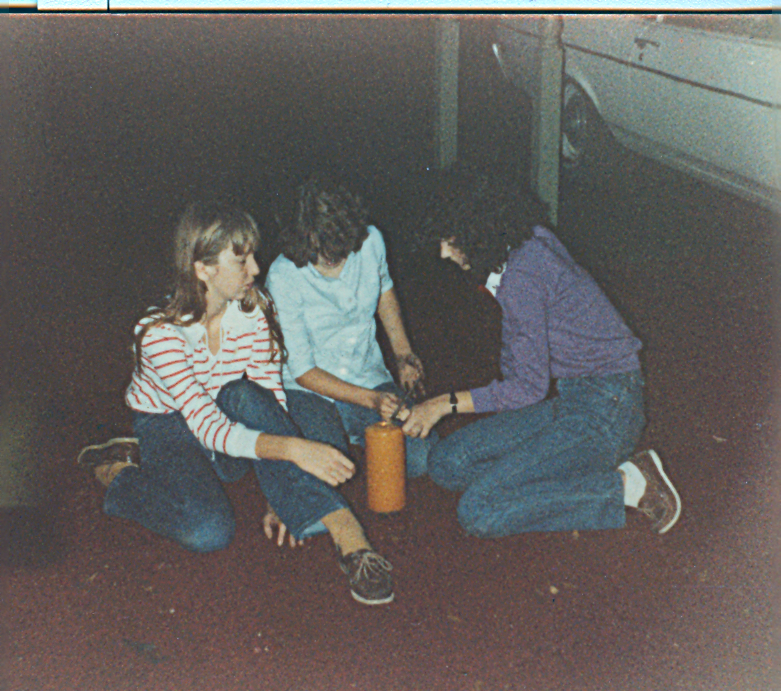 C., K., and I try to light old sparklers