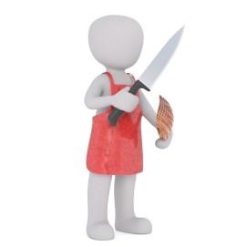 Figurine de boucher couteau à la main