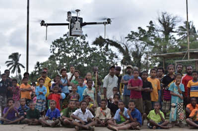 Relief Response Team using drones to map out disaster area after an earthquake or flood.