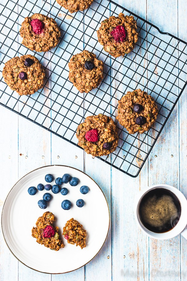 berry and oat cookies on a cooling rack
