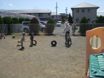 Rolling tires on our yard! Fun!