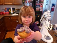 Sienna shows off the finished product in her favorite color of frosting