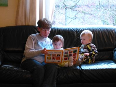 Ooma reading to Audrey and Jamie