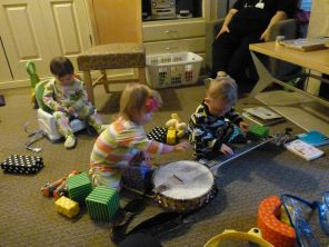 Audrey gets a good seat while TK and Jamie check out the instrument