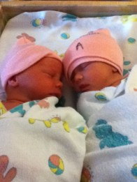The girls slept in the same crib, trying to stay warm.