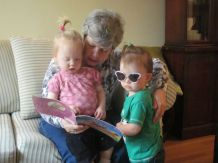 Nana reads with two cool kids.