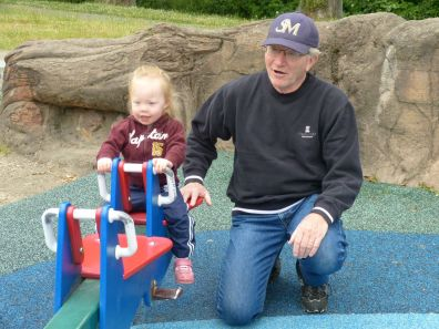 Grampy gives Theresa a see-saw ride.