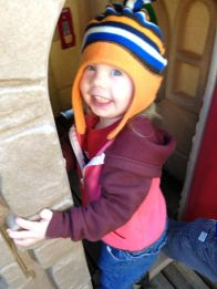 Theresa plays peek-a-boo in our new play house.