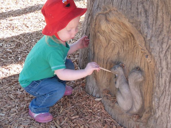 Feeding the squirrel at the park