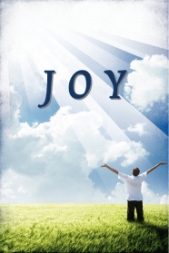 Man in a field with his hands raised in joy