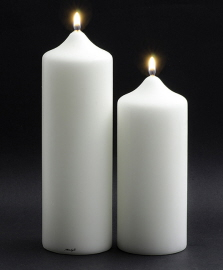 White lit pillar candles with black background