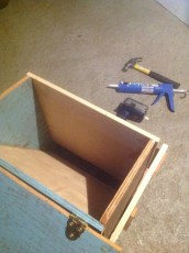 the food bin lid open showing the angled board to help food move into the hopper