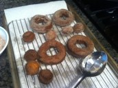 Cooked and sugared doughnuts cooling on the paper towels