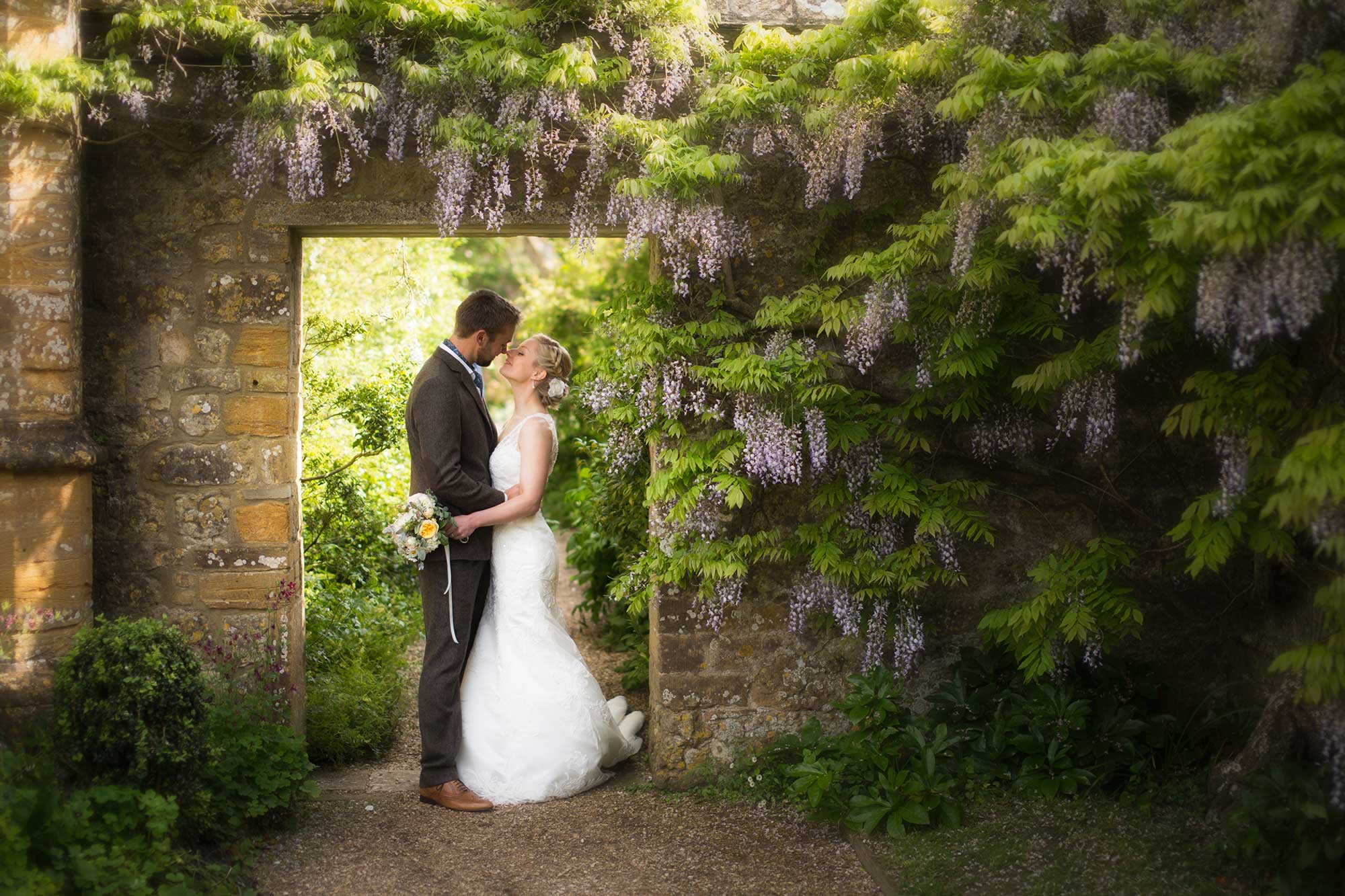 Under the Wisteria at Mapperton Gardens - Dorset wedding venue