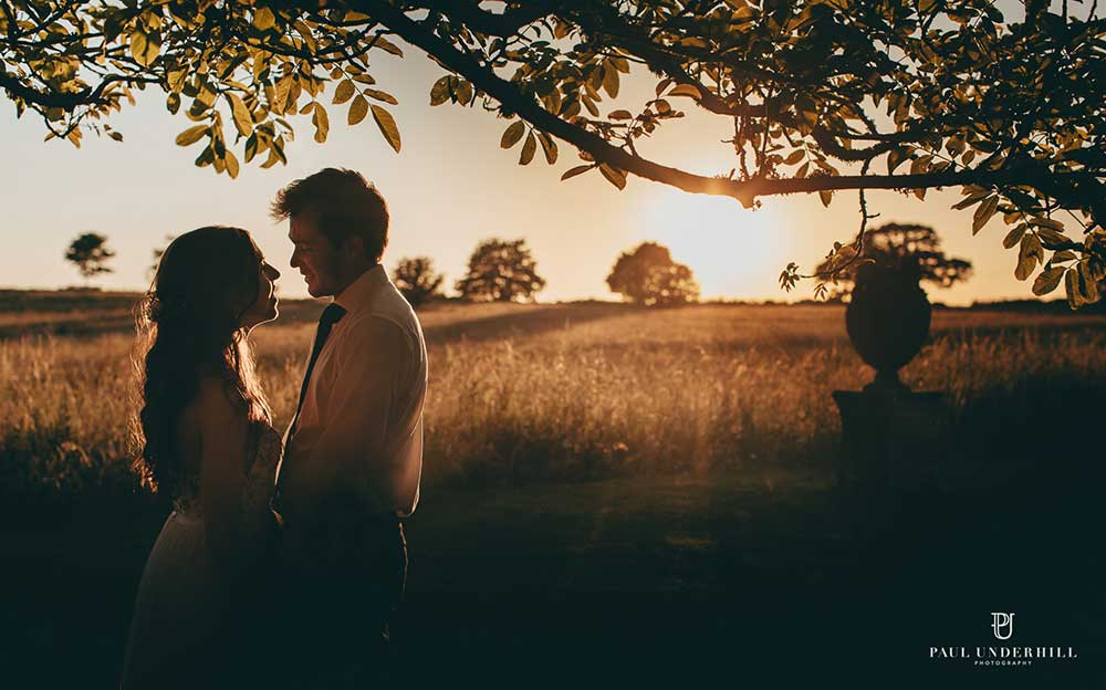 A couple at sunset - photo by Paul Underhill Photography