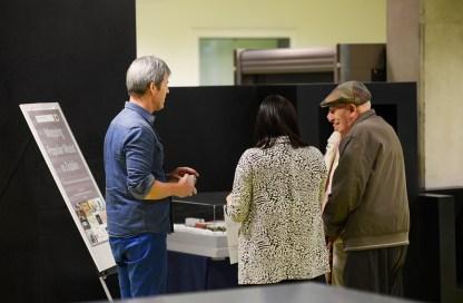 John O'Flynn and Áine Mangaoang chatting with Drumcondra residents