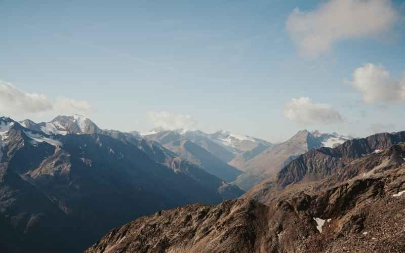 mountainous terrain with high snowy tops