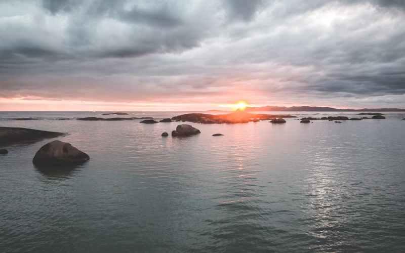 sunset sky over calm rippling sea