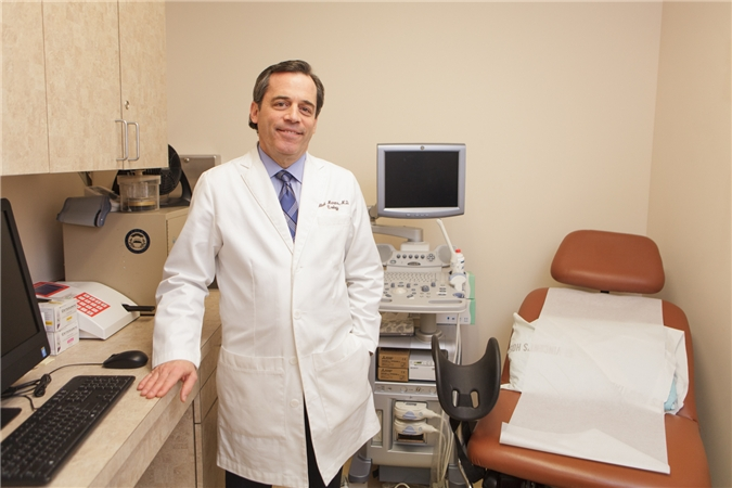 Dr. Hillel Marans in his examination room in NYC