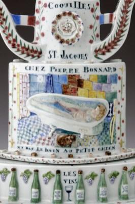 """Mara Superior, """"Belle France"""", 2005, 22"""" x 19"""" x 8.5"""", high-fired porcelain, ceramic oxides, underglaze, glaze, wood base, gold leaf, bone label, brass pins."""