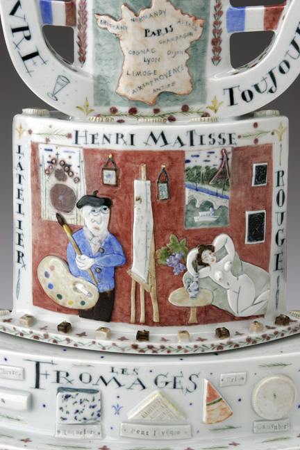 "Mara Superior, ""Belle France"", 2005, 22 x 19 x 8.5"", high-fired porcelain, ceramic oxides, underglaze, glaze, wood base, gold leaf, bone label, brass pins."