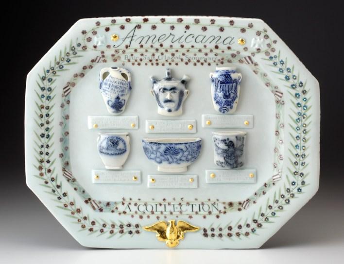 "Mara Superior, ""Americana: A Collection of Blue Salt-glazed Stoneware"", 2016, 14.5 x 17.5 x 1.5"", platter: high-fired porcelain, ceramic oxides, underglaze, glaze, gold leaf; miniature delft chargers: salt-glaze, stoneware."