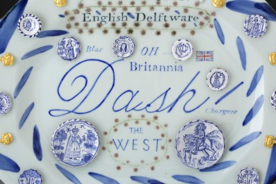 """Mara Superior, """"English Delftware: A Collection of Blue Dash Chargers"""", 2016, 12.5 x 16 x 1.5"""", high-fired porcelain, ceramic oxides, underglaze, glaze, gold leaf. Everson Museum of Art."""