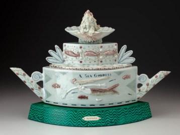 """Mara Superior, """"Fantasia Teapot"""", 2007, 13.5 x 8.5 x 20"""", high-fired porcelain, ceramic oxides, underglaze, glaze, faux painting, wood, brass pins. Crocker Art Museum."""