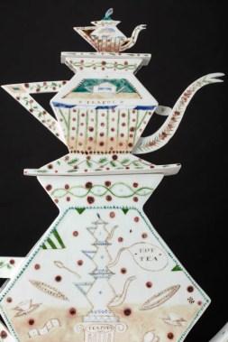 "Mara Superior, ""Tea Totem"", 1991, 24.25 x 21.5 x 4.5"", high-fired porcelain, ceramic oxides, underglaze, glaze, wood base."