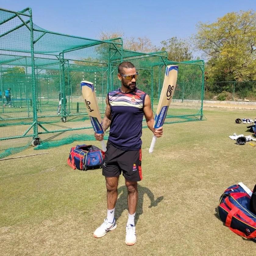 Shikhar Dhawan with Two Bat