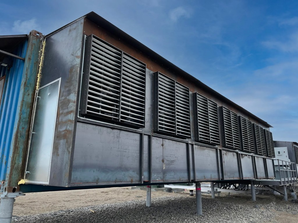 Photo of Hardin, Montana data center. Exterior shot of custom modified shipping containers.
