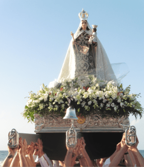 """Members of Marbella´s religious Brotherhood of Nuestra Señora del Carmen, heaved the throne high above their heads to the cries of """"Viva la Virgen del Carmen!"""""""