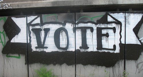 """Hand-painted """"Vote"""" sign"""