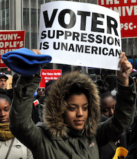 "Woman holding sign that says ""Voter Suppression is Unamerican"""