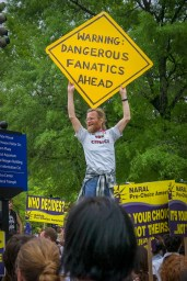 "Abortion Rights: Man holding sign, ""Warning: Dangerous Fanatics Ahead"" during the March for Women's Lives, April 25, 2004"