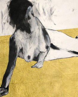 Figure propped gold leaf