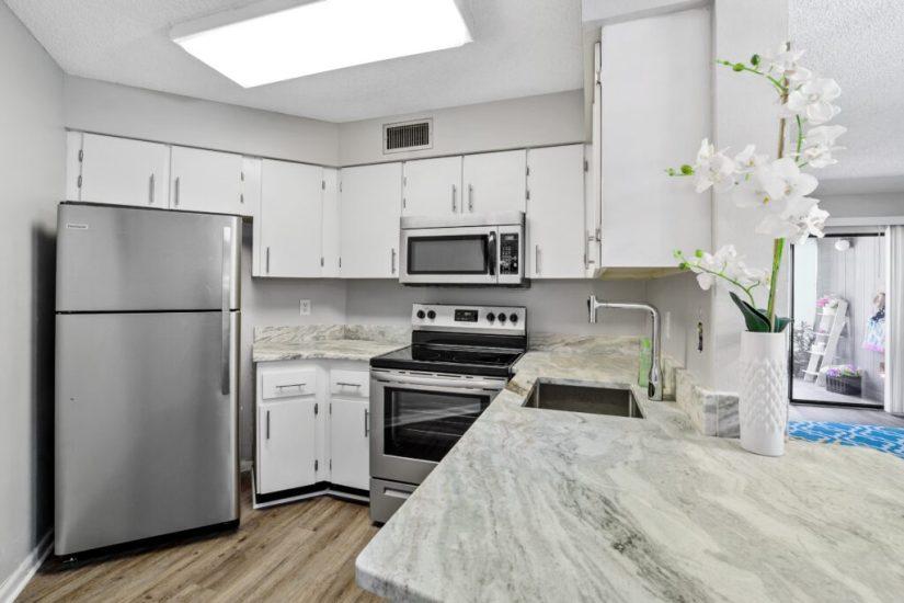 White and gray kitchen in condo