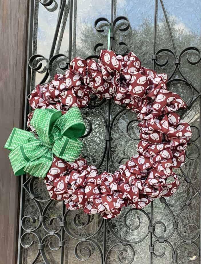 super bowl wreath hanging on door